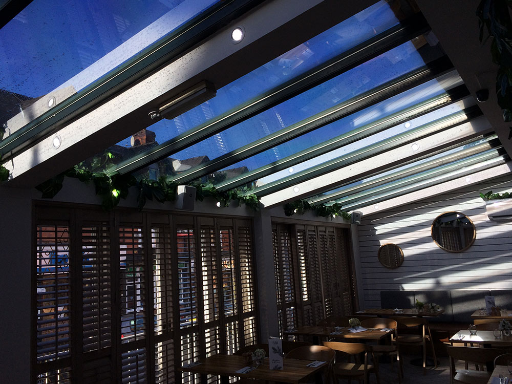 Picture of anti glare and heat recuing window film installed in an atrium of a bar in Manchester.